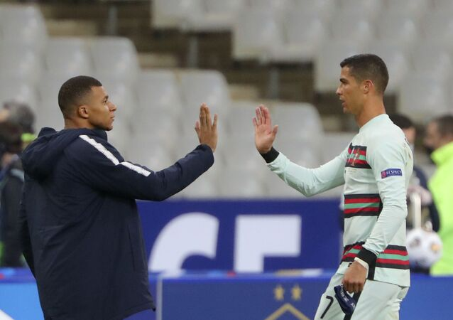 FILE - In this Sunday, Oct. 11, 2020 file photo France's Kylian Mbappe and Portugal's Cristiano Ronaldo, right, greet each other before the UEFA Nations League soccer match between France and Portugal at the Stade de France in Saint-Denis, north of Paris, France
