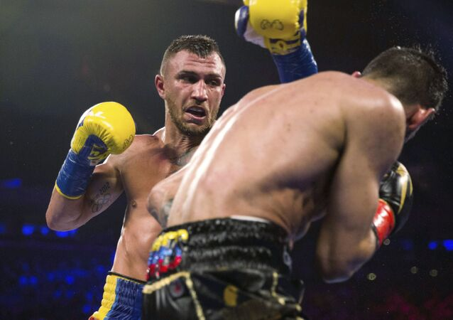 Vasyl Lomachenko, of Ukraine, throws a punch at Jorge Linares, of Venezuela, during the WBA lightweight championship fight in 2018.