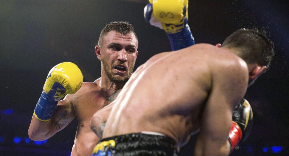 Vasyl Lomachenko, of Ukraine, throws a punch at Jorge Linares, of Venezuela, during the WBA lightweight championship fight in 2018.