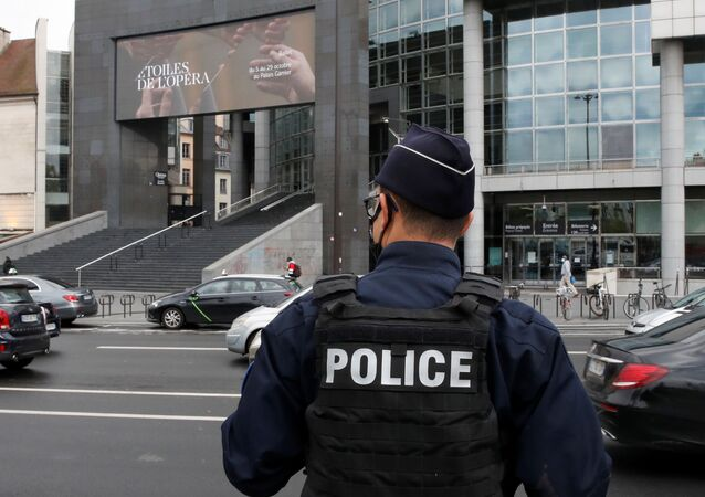 A French police stands near the Opera Bastille where a suspect in a stabbing attack near the former offices of the magazine Charlie Hebdo has been arrested in Paris, France September 25, 2020