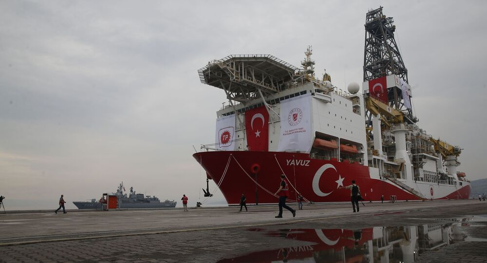 A Turkish Navy vessel patrols as the drilling ship 'Yavuz' to be dispatched to the Mediterranean, is docked at the port of Dilovasi, outside Istanbul,Thursday, June 20, 2019
