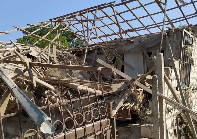 Scene from a residential building destroyed by recent shelling, in Agdam district, in the self-proclaimed Nagorno-Karabakh Republic. The cease-fire in the Karabakh region between Armenia and Azerbaijan came into effect on 10 October, but was immediately challenged by mutual claims of violations that have persisted since then.