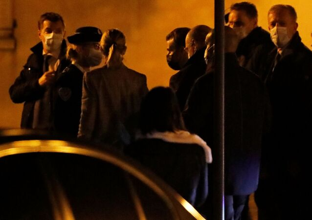 French President Emmanuel Macron arrives to visit the scene of a stabbing attack in the Paris suburb of Conflans St Honorine, France, October 16, 2020.