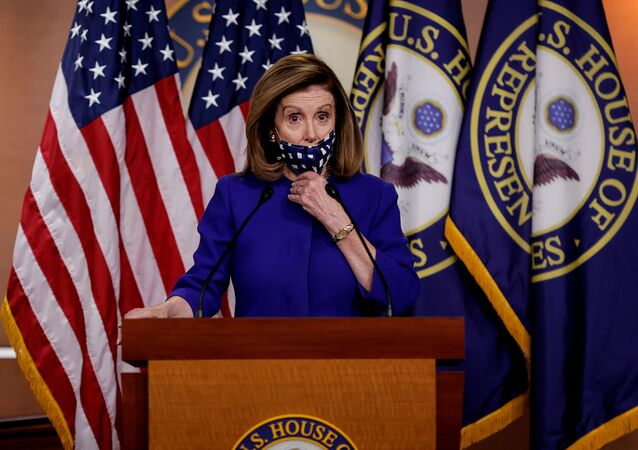 U.S. House Speaker Nancy Pelosi adjusts her face mask as she announces her plans for Congress to create a Commission on Presidential Capacity to Discharge the Powers and Duties of Office Act, after U.S. President Donald Trump came down with coronavirus disease (COVID-19), during a Capitol Hill news conference in Washington, U.S., October 9, 2020.