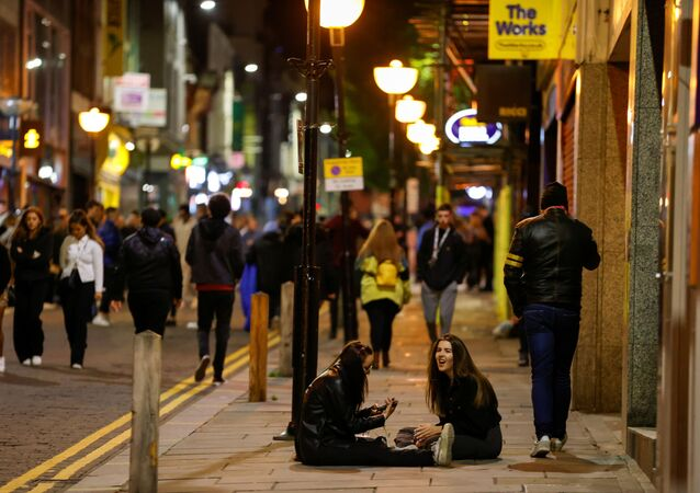 People walk and gather outside bars the night before a local lockdown amidst the spread of the coronavirus disease (COVID-19) in Liverpool, Britain 13 October 2020.