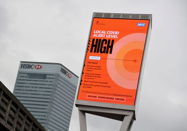 A government local COVID-19 alert level sign is pictured amid the outbreak of the coronavirus disease (COVID-19) in London, Britain, October 17, 2020.