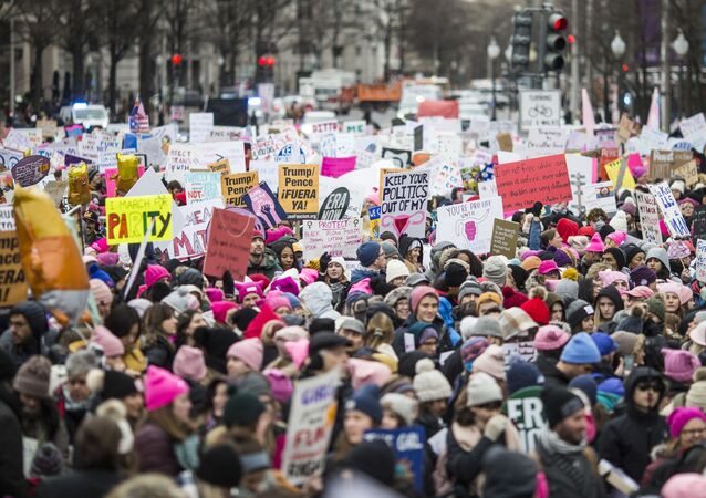 Demonstrators carry signs during the 2020 Women's March on January 18, 2020 in Washington, DC. Marches were held nationwide in cities including New York and Los Angeles.