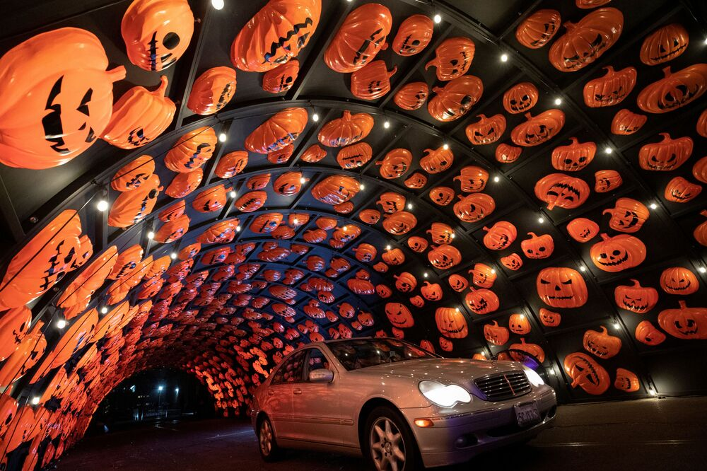 A vehicle drives through the HAUNT'OWEEN LA Halloween drive-through experience, in Woodland Hills, California, US, 8 October 2020.