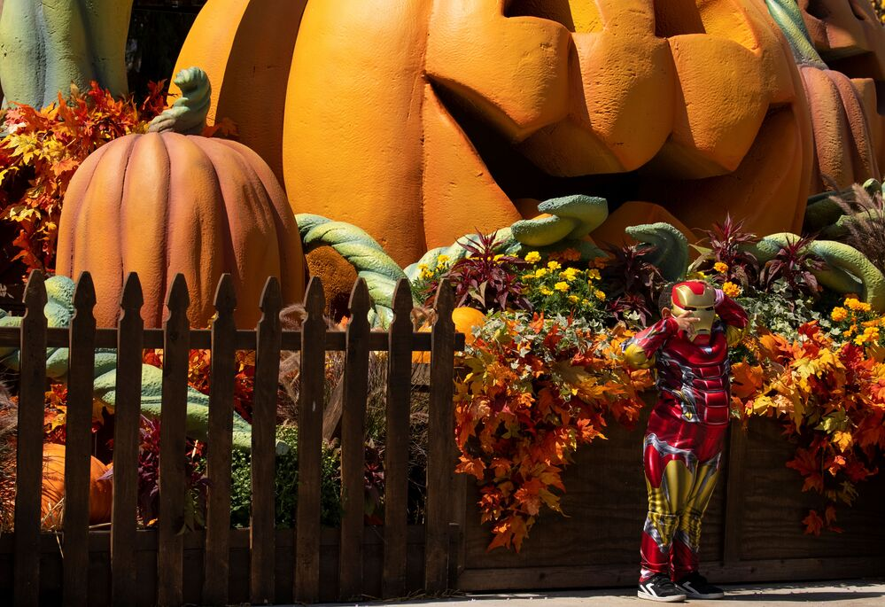 A young boy wearing a costume attends Knott's Berry Farm's Halloween-themed attraction in Buena Park, California, US, 25 September 2020.