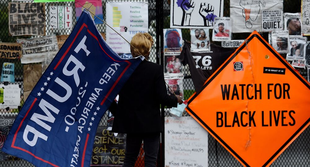 A supporter of US President Donald Trump arrives at Black Lives Matter Plaza in Washington, DC, on 10 October 2020, before a speech by the American President at the White House.