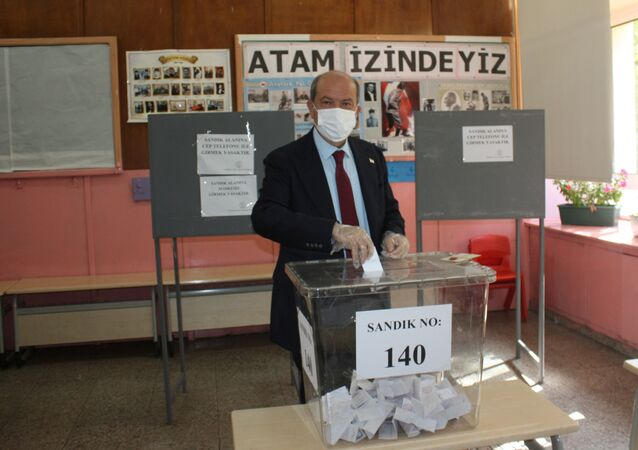 Turkish Cypriot presidential candidate Ersin Tatar casts his vote at a polling station during Turkish Cypriot presidential elections in northern Nicosia, Cyprus October 18, 2020.