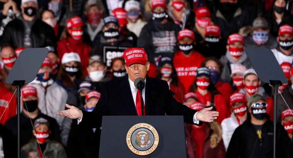 US President Donald Trump speaks during a campaign rally at Southern Wisconsin Regional Airport in Janesville, Wisconsin, 17 October 2020.