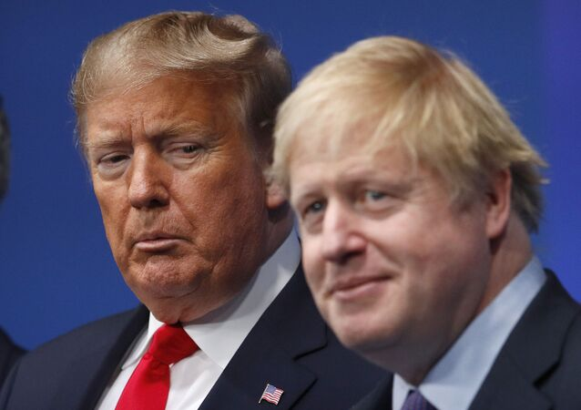 British Prime Minister Boris Johnson, right, and U.S. President Donald Trump pose during a group photo during a NATO leaders meeting at The Grove hotel and resort in Watford, Hertfordshire, England, Wednesday, Dec. 4, 2019