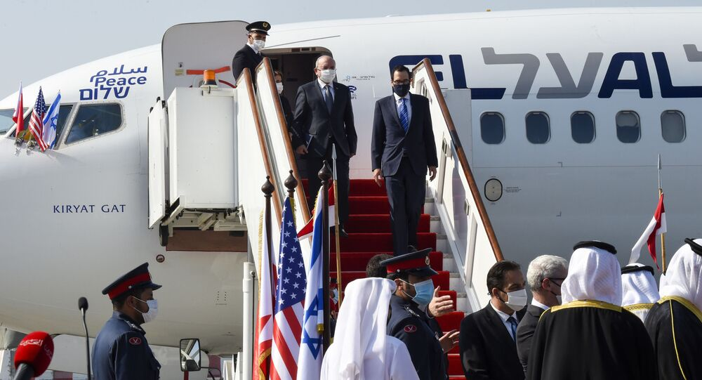 Head of Israel's National Security Council Meir Ben-Shabbat (L) and US Treasury Secretary Steve Mnuchin disembark from a plane upon their arrival at the Bahraini International Airport on October 18, 2020.