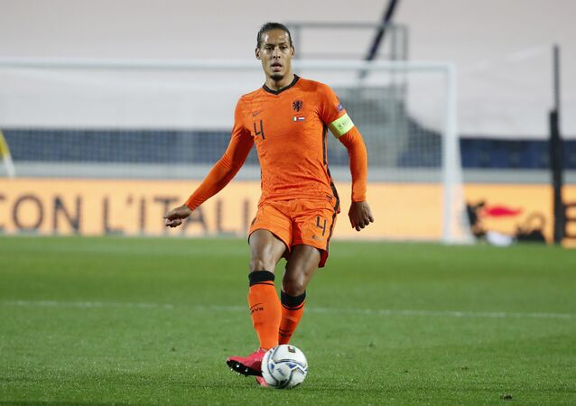 Netherlands' Virgil Van Dijk kicks the ball during the UEFA Nations League soccer match between Italy and Netherlands at Azzurri d'Italia stadium in Bergamo, Italy, Wednesday, 14 October 2020.