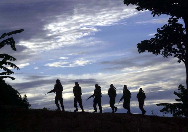 Indian army commandos patrol on a ridge during a jungle survival training session at the Counter Insurgency and Jungle Warfare School (CIJWS) in Vairengte, 38 miles north of Aizawal, capital of the northeastern India state of Mizoram, Saturday, Sept. 11, 2004