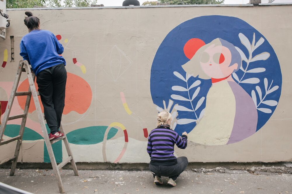 Serbian graffiti artists work on creations in Belgrade, as part of the Mural Festival 'Reconstruction' on 27 September 2020.