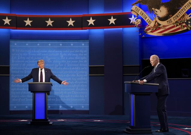 President Donald Trump, left, reacts as former Vice President Joe Biden speaks during the first presidential debate on 29 September 2020, at Case Western University in Cleveland, Ohio