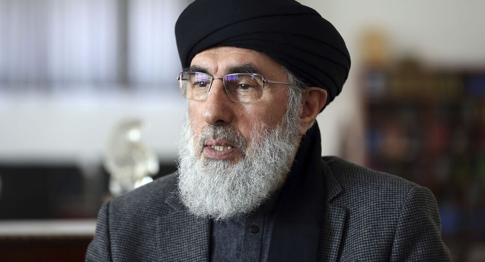 In this Tuesday, Feb. 25, 2020 photo, Afghan warlord Gulbuddin Hekmatyar, speaks during an interview to the Associated Press in his home in Kabul, Afghanistan