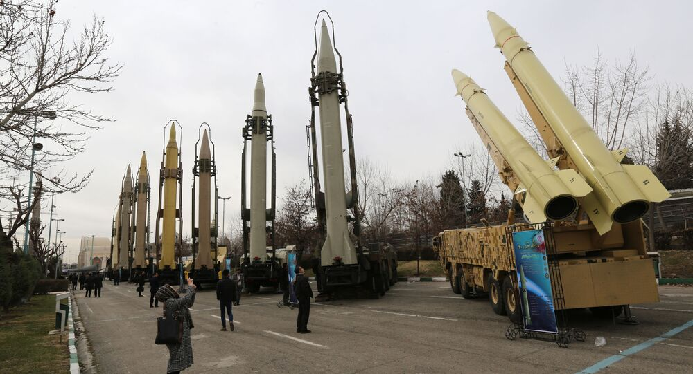 A file photo taken on February 2, 2019 shows Iranians visiting a weaponry and military equipment exhibition in the capital Tehran, organised on the occasion of the 40th anniversary of the Iranian revolution. - A longstanding UN embargo on arms sales to and from Iran expired early on October 18, 2020, in line with a 2015 landmark nuclear deal, the Iranian foreign ministry said.