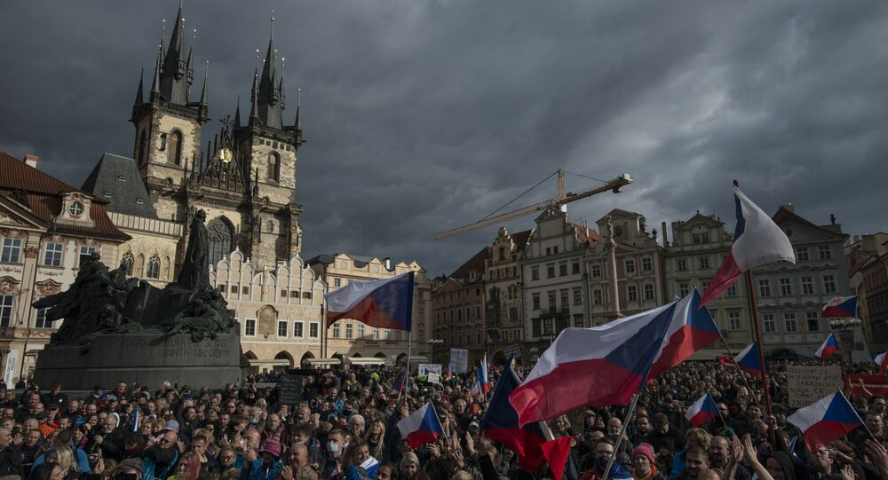 Hundreds of demonstrators, including football supporters, protest against the Czech government's new measures to slow the spread of the Covid-19 coronavirus in Prague on 18 October 2020.