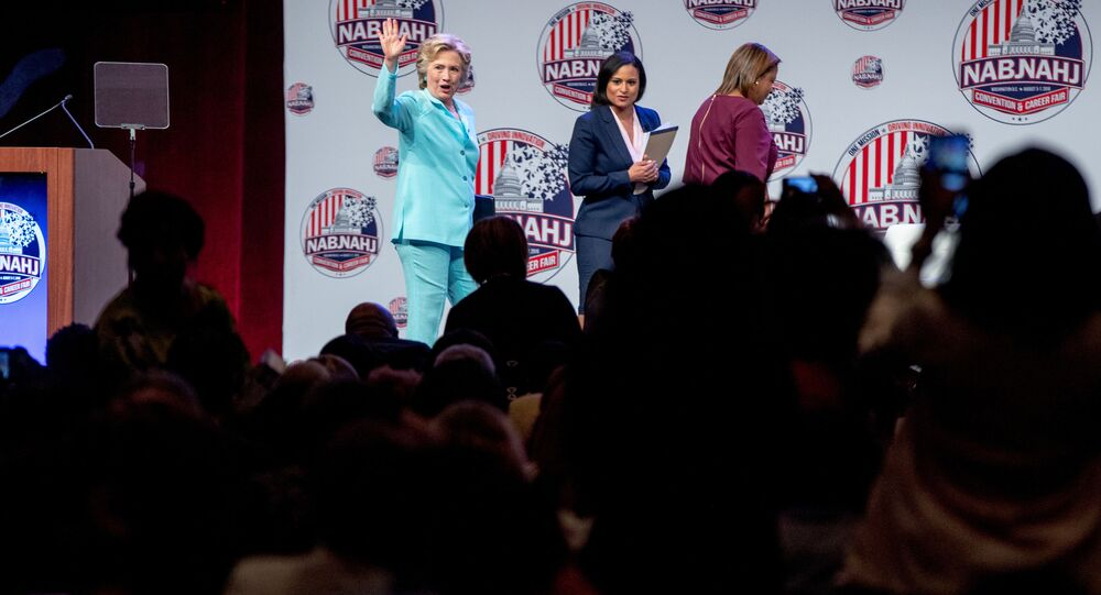 Democrat presidential candidate Hillary Clinton, left, accompanied by NBC reporter Kristen Welker, center, and Telemundo reporter Lori Montenegro, waves as she leaves after speaking at the 2016 National Association of Black Journalists' and National Association of Hispanic Journalists' Hall of Fame Luncheon at Marriott Wardman Park in Washington, Friday, 5 August 2016.