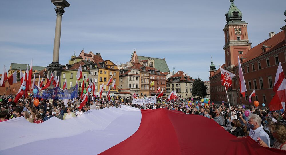 Participants carry the Polish flag during the March for Life and Family in Warsaw, Poland September 20, 2020