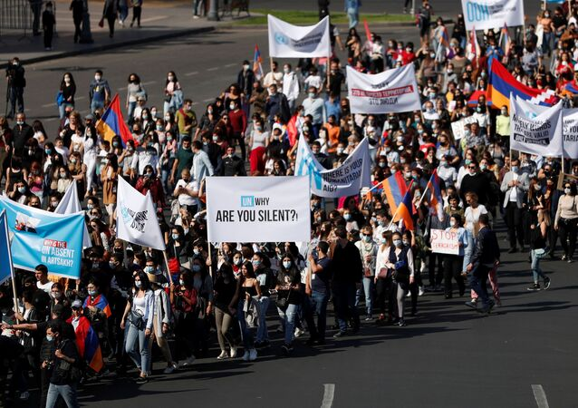 People march as they protest against what they call the inaction of the international community regarding the military conflict over the breakaway region of Nagorno-Karabakh, in Yerevan, Armenia October 19, 2020.