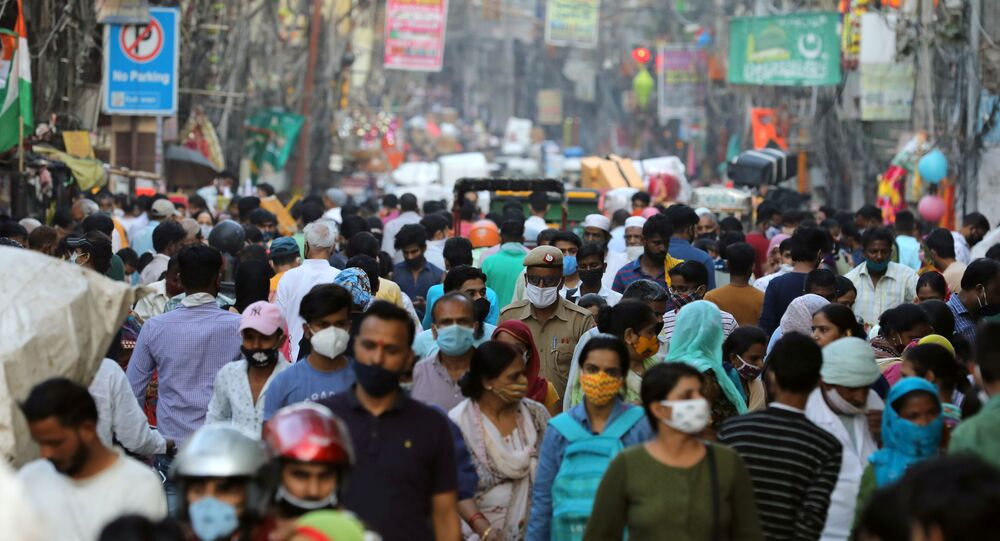 People are seen at a market amidst the spread of the coronavirus disease (COVID-19), in the old quarters of Delhi, October 19, 2020.