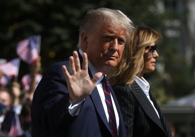 U.S. President Donald Trump waves to reporters as he departs with first lady Melania Trump for campaign travel to participate in his first presidential debate with Democratic presidential nominee Joe Biden in Cleveland, Ohio from the South Lawn at the White House in Washington, U.S., September 29, 2020. President Trump recently announced that he and the first lady have both tested positive for the coronavirus disease (COVID-19). Picture taken September 29, 2020.