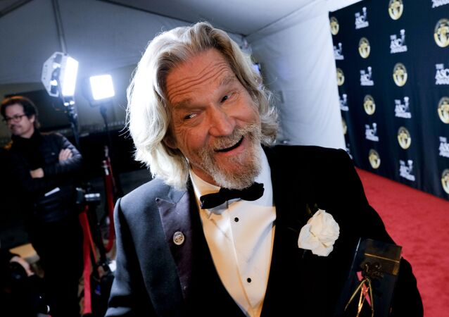 This Saturday, Feb. 9, 2019 photo actor Jeff Bridges talks to reporters after receiving the Board of Governors Award at The 33rd annual American Society of Cinematographers Awards at the Ray Dolby Ballroom in Los Angeles.