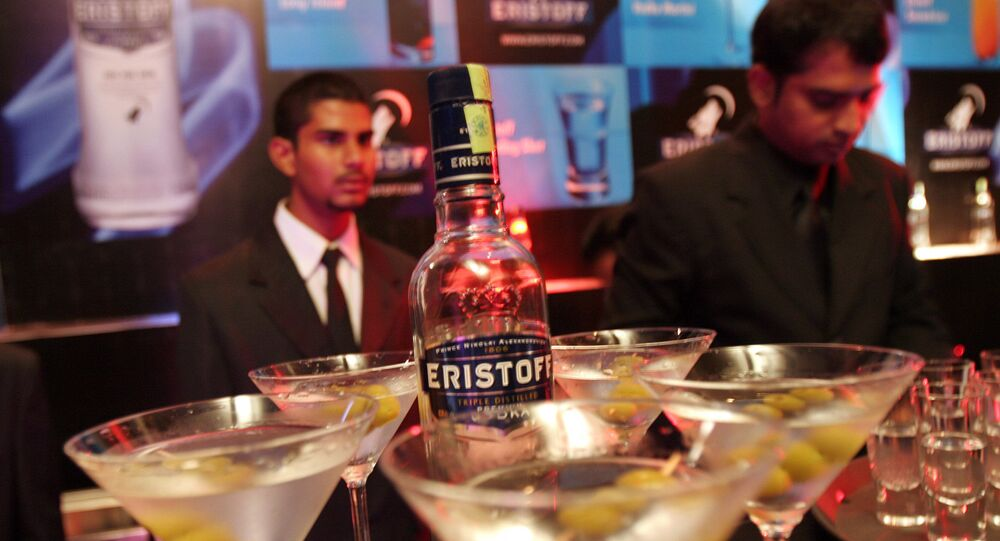 Bar tenders prepare cocktails made of Eristoff vodka at its launch in Bangalore, India, Wednesday, May 30, 2007