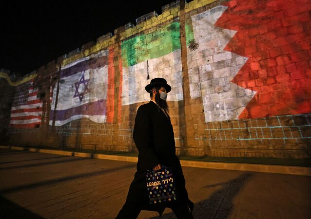 The flags of US, Israel, United Arab Emirates, and Bahrain are projected on the ramparts of Jerusalem's Old City on September 15, 2020 in a show of support for Israeli normalisation deals with the United Arab Emirates and Bahrain.