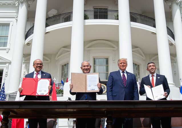 (L-R)Bahrain Foreign Minister Abdullatif al-Zayani, Israeli Prime Minister Benjamin Netanyahu, US President Donald Trump, and UAE Foreign Minister Abdullah bin Zayed Al-Nahyan hold up documents after participating in the signing of the Abraham Accords where the countries of Bahrain and the United Arab Emirates recognize Israel, at the White House in Washington, DC, September 15, 2020.