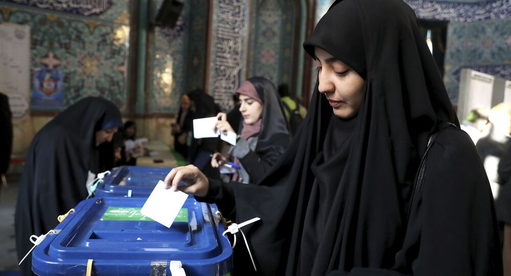 An Iranian woman casts her vote at a polling station in Tehran, Iran, Friday, 21 February 2020.