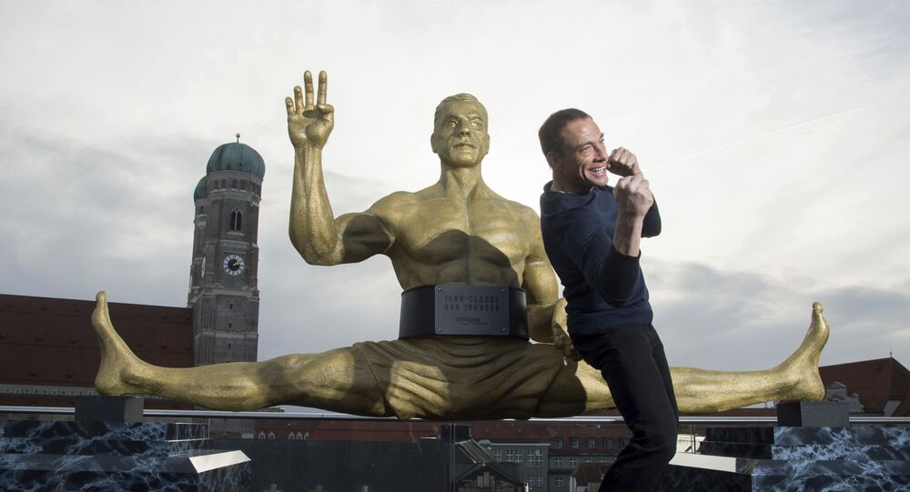 Actor Jean-Claude Van Damme strikes a pose during a press conference to announce his forthcoming lead role, in Munich, Germany Thursday 14 December 2017.
