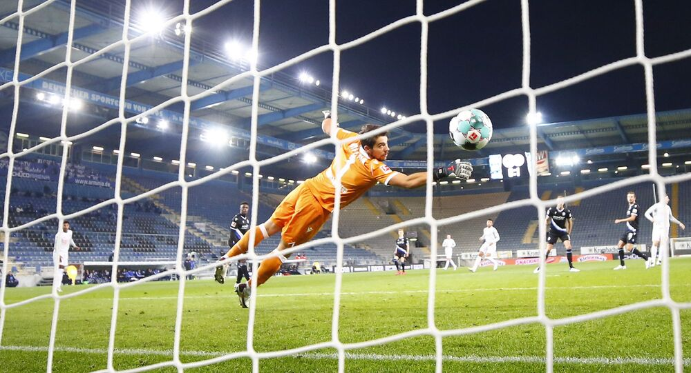 Bayern Munich's Robert Lewandowski scores the team's second goal during the game with Arminia Bielefeld on 17 October 2020.