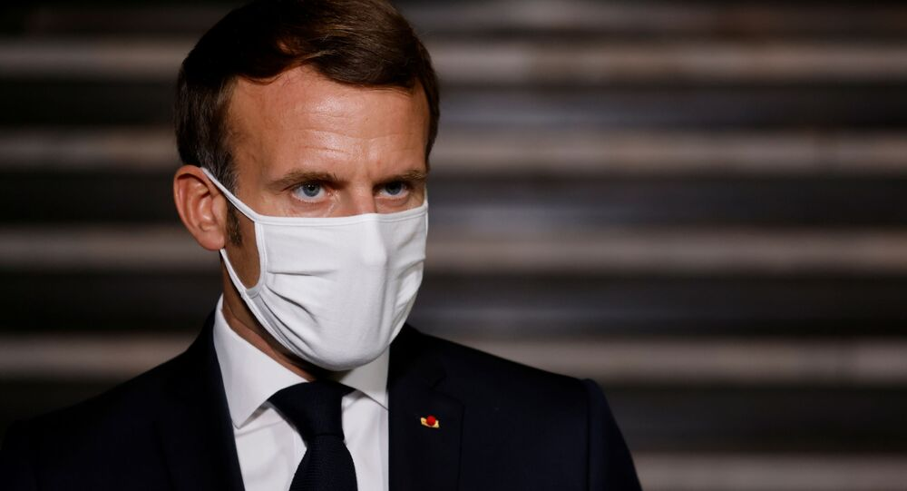 French President Emmanuel Macron wearing a face mask delivers a speech at the end of a visit about the fight against separatism at the Seine-Saint-Denis prefecture headquarters in Bobigny, near Paris, France October 20, 2020.