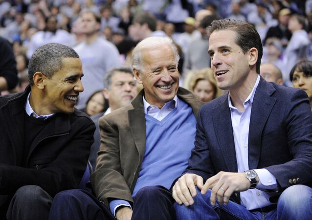 This Jan. 30, 2010 file photo shows Hunter Biden, right, son of Vice President Joe Biden, center, talking with President Barack Obama, and the vice president Joe Biden during a college basketball game in Washington.  Biden's youngest son Hunter is joining the Navy. The Navy says the attorney and former Washington lobbyist was selected to be commissioned into the Navy Reserve as a public affairs officer. Because he is 42, he needed a special waiver to be accepted, but that is not uncommon. He is one of seven candidates recommended for a direct commission for public affairs.