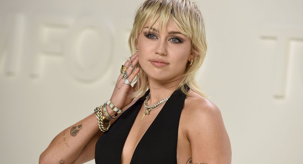 In this Feb. 7, 2020 file photo, actress-singer Miley Cyrus attends the Tom Ford fashion show in Los Angeles.