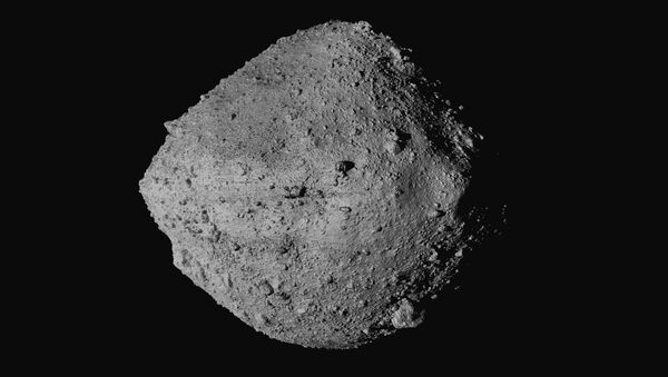 This undated image made available by NASA shows the asteroid Bennu from the OSIRIS-REx spacecraft. After almost two years circling the ancient asteroid, OSIRIS-REx will attempt to descend to the treacherous, boulder-packed surface and snatch a handful of rubble on Tuesday, Oct. 20, 2020. - Sputnik International