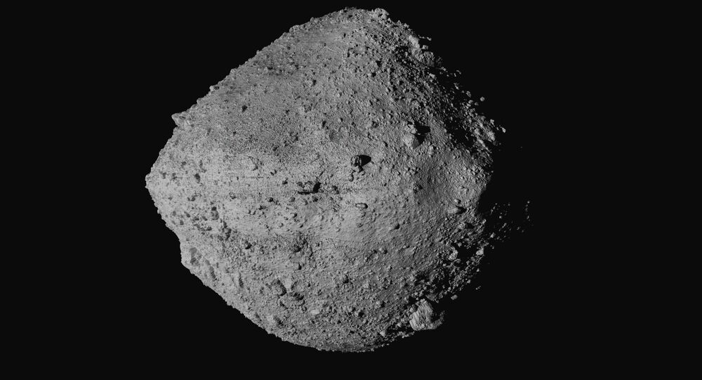 This undated image made available by NASA shows the asteroid Bennu from the OSIRIS-REx spacecraft. After almost two years circling the ancient asteroid, OSIRIS-REx will attempt to descend onto the treacherous, boulder-packed surface and snatch a handful of rubble. Tuesday, 20 October 2020.