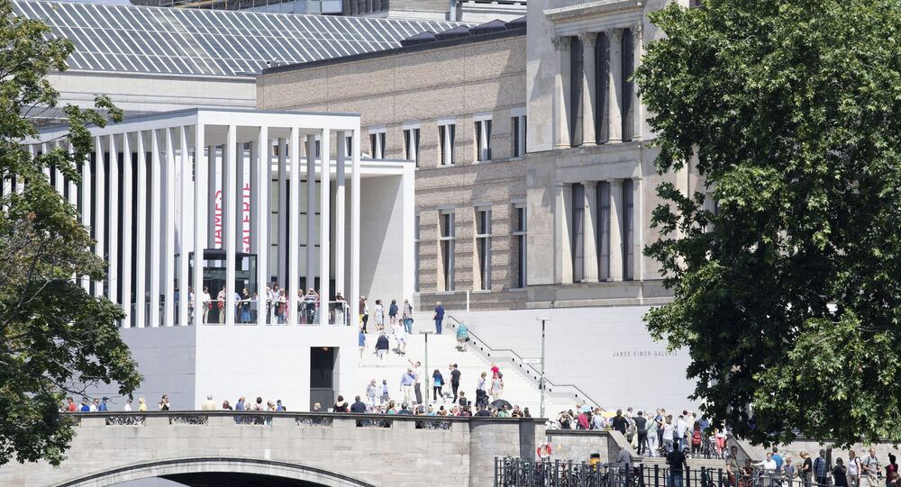 People visit the new James Simon Gallery as the ensemble's sixth building on Berlin's Museum Island, Saturday, July 13, 2019.