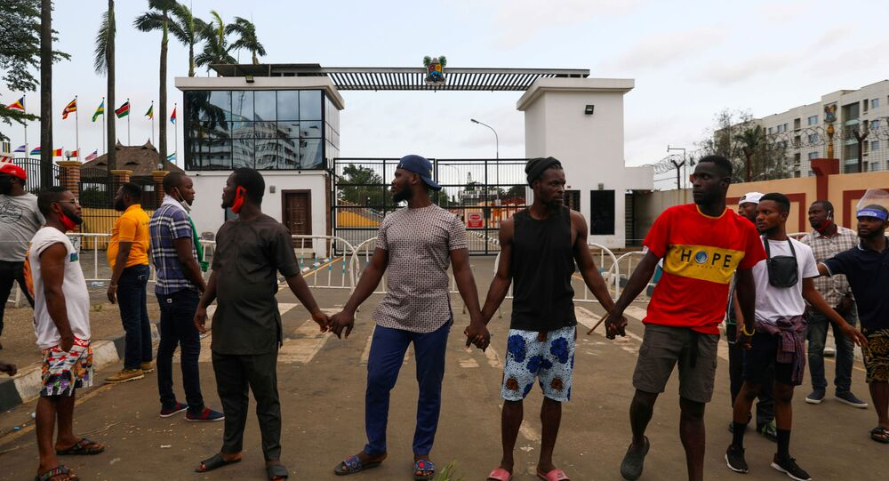 Demonstrators hold hands as they gather near the Lagos State House, despite a round-the-clock curfew imposed by the authorities on the Nigerian state of Lagos in response to protests against alleged police brutality, Nigeria October 20, 2020.