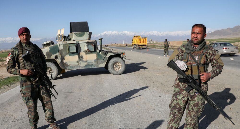 Afghan National Army (ANA) soldiers stand guard at a check point near the Bagram Airbase north of Kabul, Afghanistan April 2, 2020