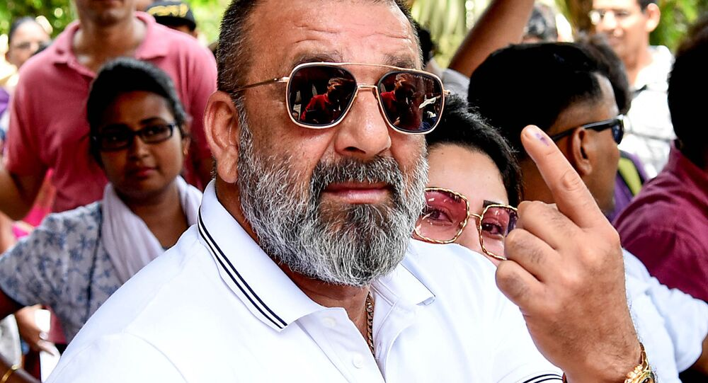 Indian Bollywood actor Sanjay Dutt poses for photographs after casting his vote at a polling station in Mumbai on April 29, 2019
