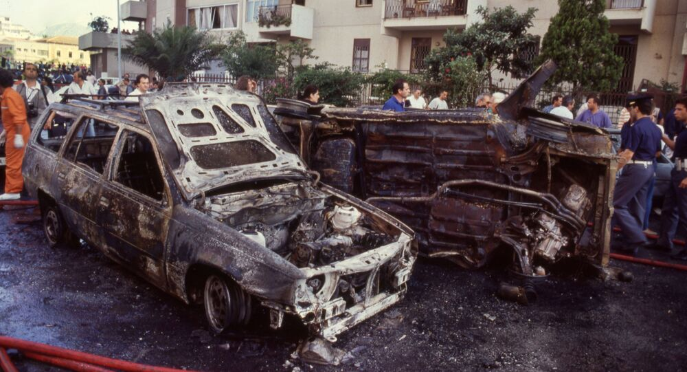 Burned cars are seen after a mafia bomb attack that killed judge Paolo Borsellino and his police guards in Palermo in 1992.