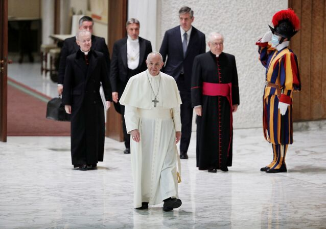 Pope Francis arrives for the weekly general audience, keeping a distance from faithful due to the coronavirus disease (COVID-19), at the Vatican, October 21, 2020.