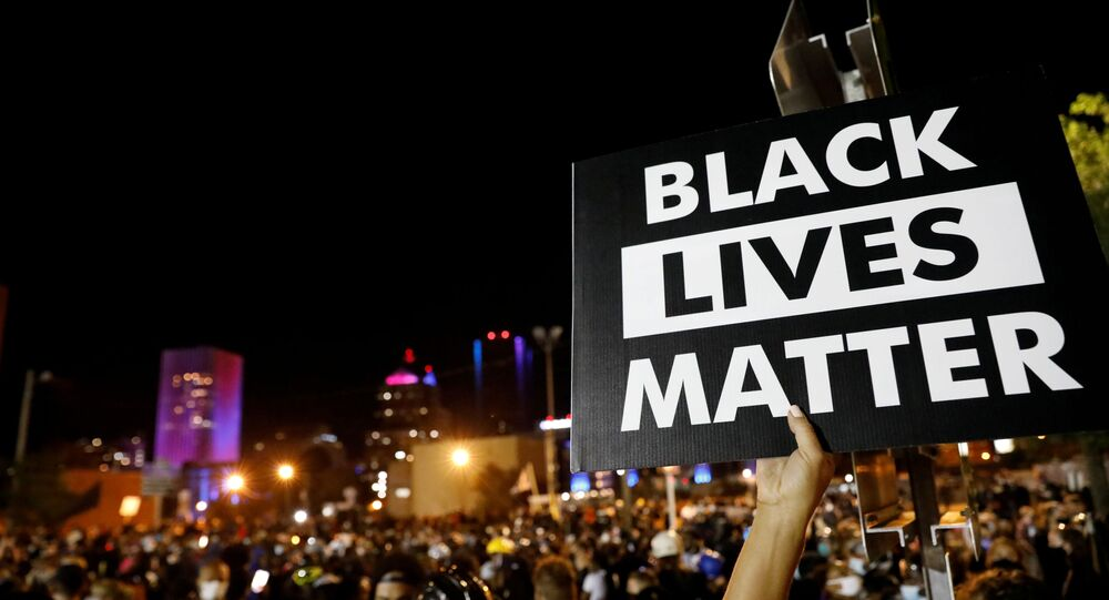 A demonstrator holds up a Black Lives Matter sign during a protest over the death of a Black man, Daniel Prude, after police put a spit hood over his head during an arrest on March 23, in Rochester, New York, U.S. September 6, 2020