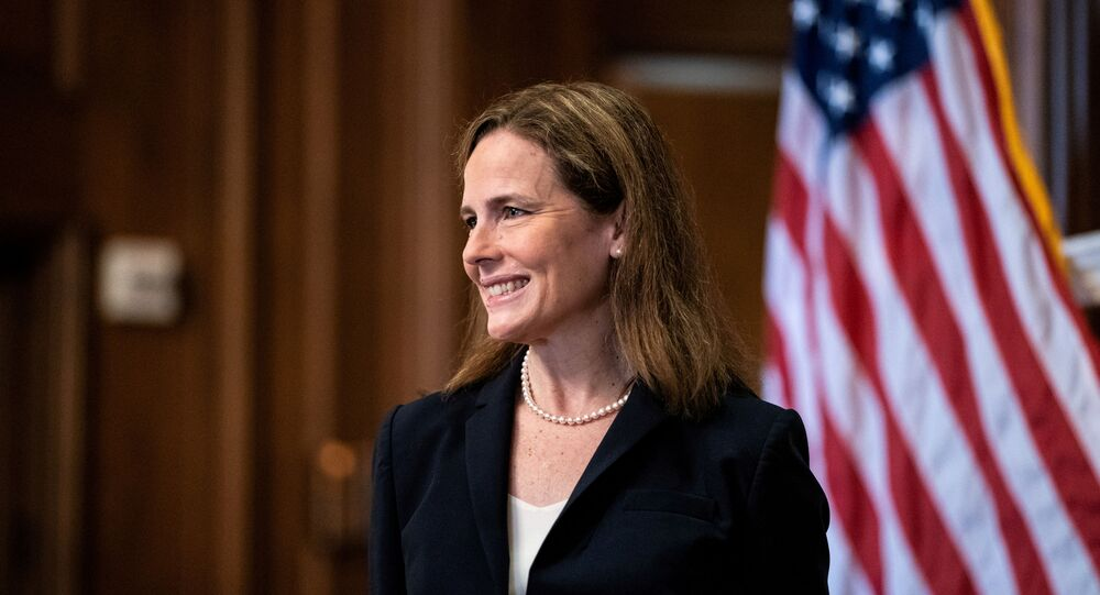 Judge Amy Coney Barrett, U.S. President Donald Trump's Nominee for Supreme Court, poses for a photo before a meeting with Senator Roy Blunt (R-Mo) on Capitol Hill in Washington DC, U.S. October 21, 2020.